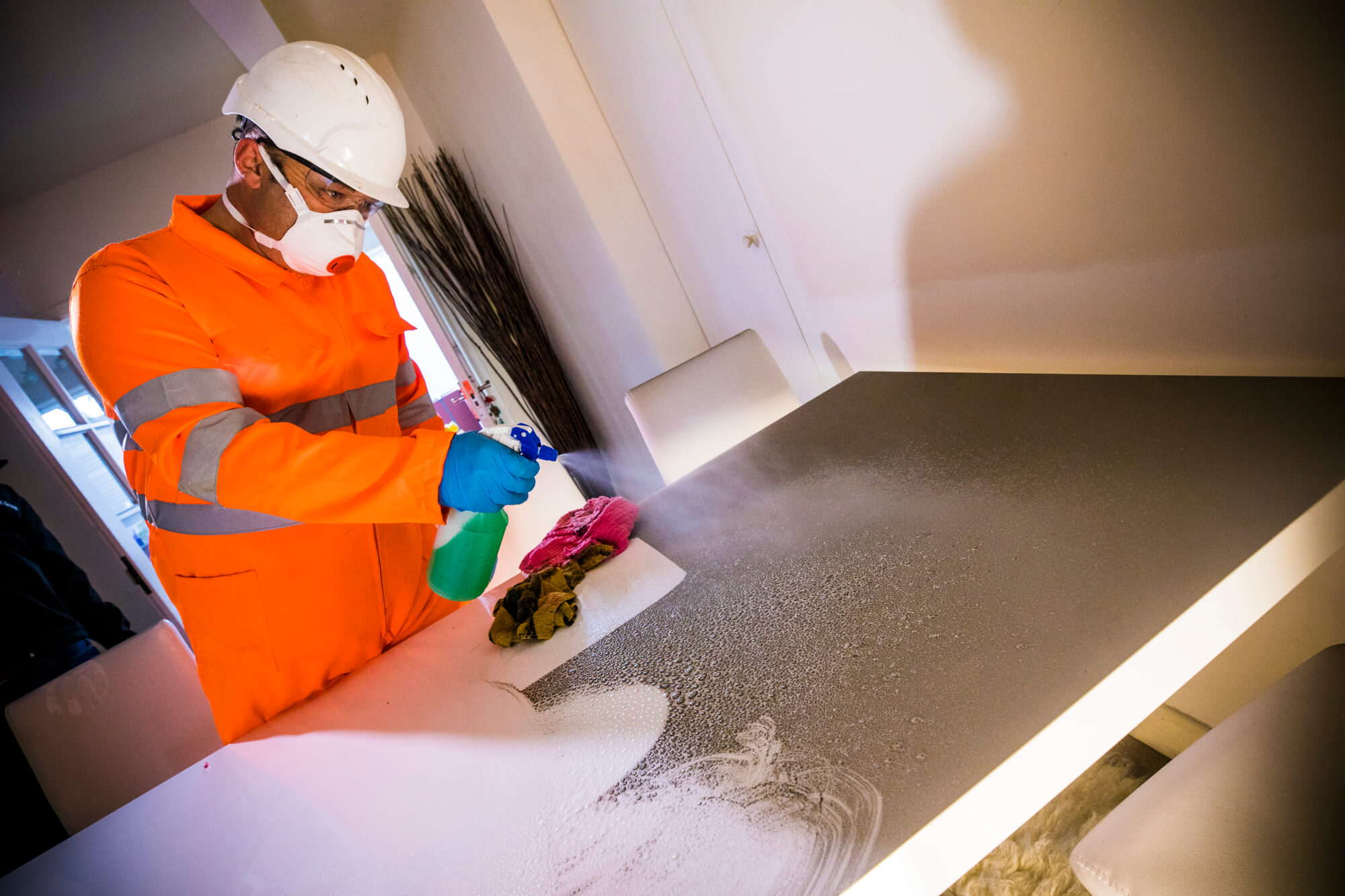 Ideal Response Technician Removing Soot from Table